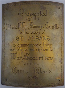 This brass plaque was presented to the people of St Albans in recognition of the huge sum of over £100,000 raised during Guns Week in 1918. | St Albans Museums