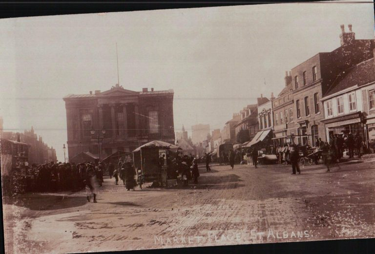 Former WWI soldier Henry Salvidge was living at 16 Christopher Yard in 1921. He suffered ill health after the war but despite this ran a coffee stall in Market Place until forced to quit by the Council as his stall was getting in the way of traffic. This postcard of Market Place is believed to show Salvidge's coffee stall. | SAHAAS