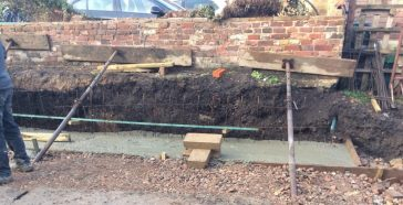 Fig. 1. Build-up of Victorian garden soil which continued below the foundation for the new retaining wall | (© Simon West, 2019)